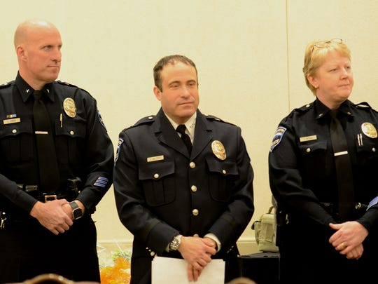 From left, Deputy Chief Shawn Burke,Chief Brandon del Pozo and Deputy Chief Janine Wright listen to remarks at the annual Queen City Police Foundation award luncheon on Monday, March 13, 2017, at the Hilton Hotel in Burlington.