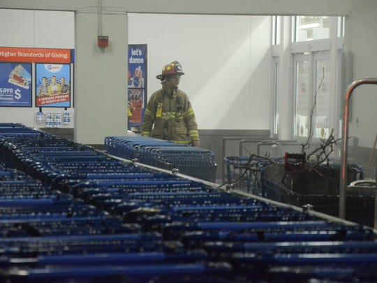 A cart pusher or electric shopping cart caught fire