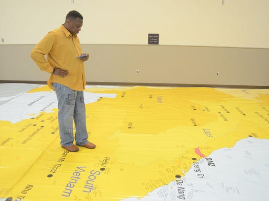 Larry Owens of Battle Creek studies the map where his eight uncles served during the Vietnam War.