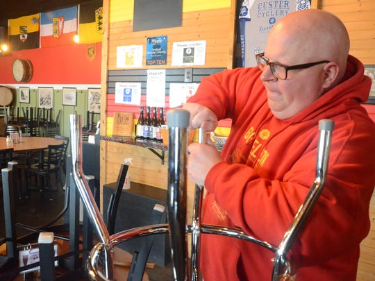 Territorial co-owner Tim Davis repairs some bar stools inside the dining room.