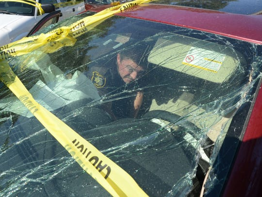 Detective Sgt. Steve Hinkley digs into the wreckage