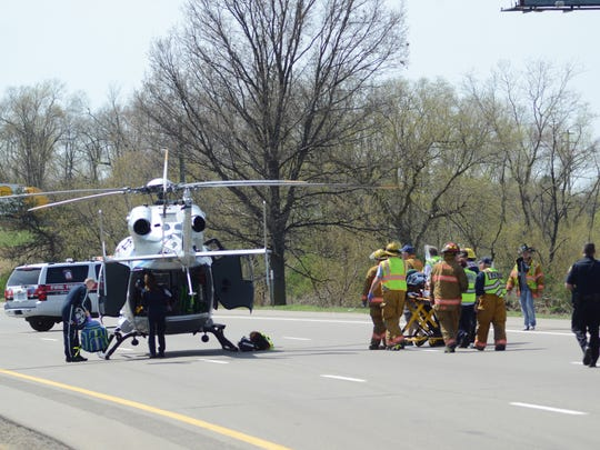 First responders take a patient to a helicopter after a crash on I-94 at 11-Mile Road in Emmett Township.