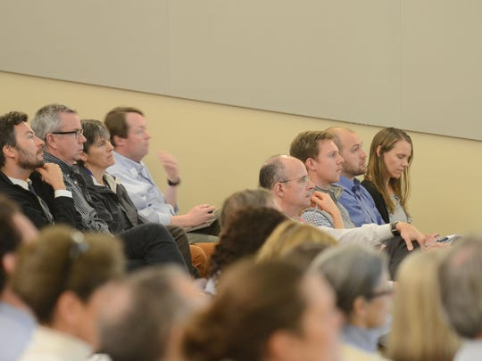 Health care professionals listen to a presentation about new rules for prescribing opioids at the University of Vermont Medical Center on Tuesday, April 18, 2017.