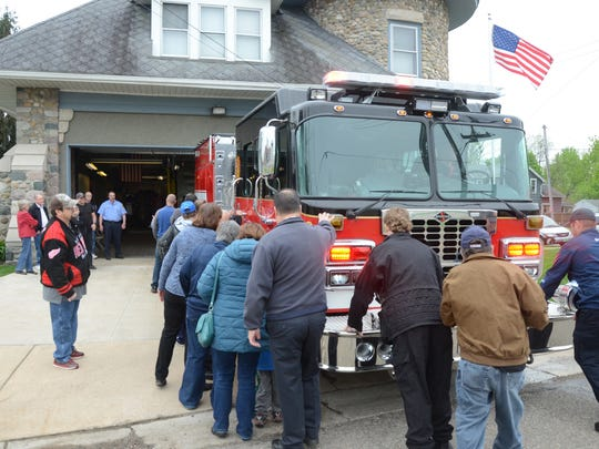 At the end of the ceremony the group symbolically pushes Rescue 3 into the fire station.