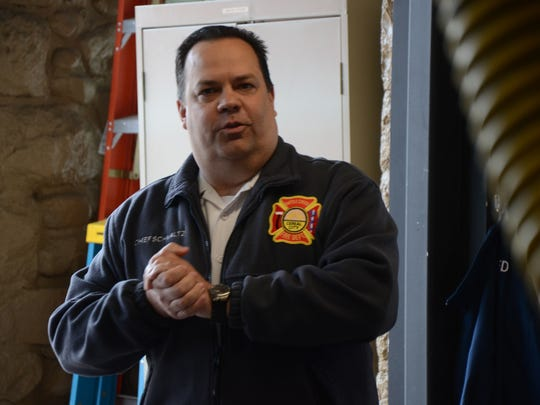 Battle Creek Fire Chief Dave Schmaltz speaks at the ceremony Saturday at Station 3.