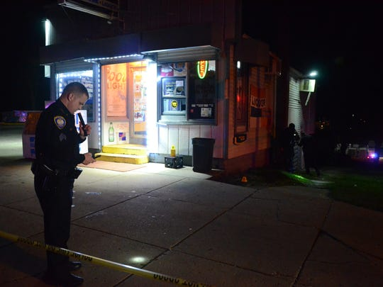 Battle Creek Police Department Sgt. Todd Elliott outside the Cliff Street Grocery after a shooting during a drug deal in April.