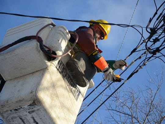 In this 2013 photo, Mark Root, a line worker for Consumers