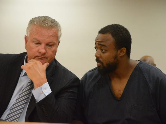 Javaan James confers with his attorney, Donald Sappanos,