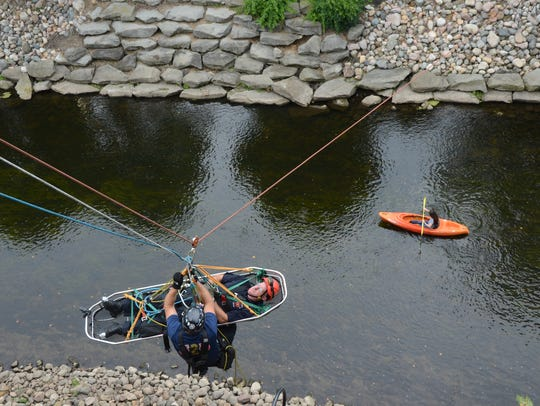 Passing kayakers had a view of rescue training on Thursday,