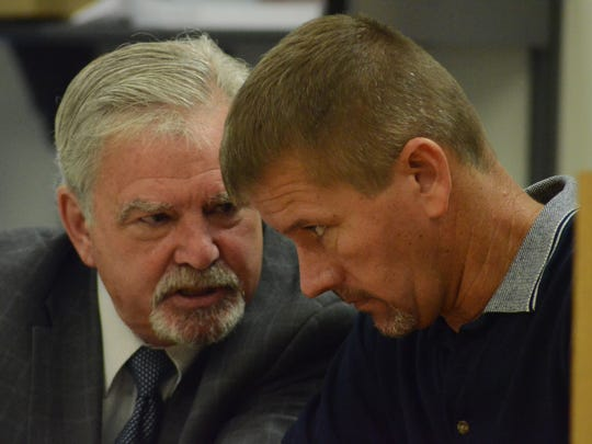 Stephen Landers listens to his attorney, David Butler