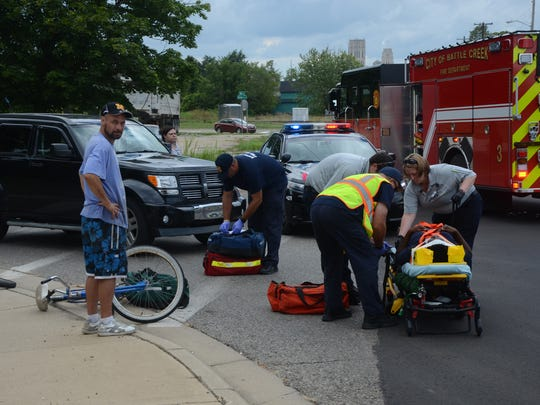 Paramedics and firefighters prepare to take a woman