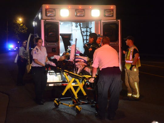 Paramedics take Keith Hendryx  to an AirCare medical