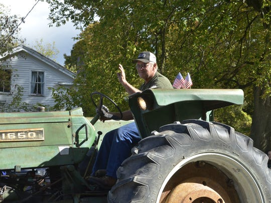 Shelburne and Charlotte, the two highest income towns in the area, saw virtually no change in their populations last year. Since 2010 Charlotte has not grown, although Shelburne has. Seen here is a participant in the 2017 Charlotte Tractor Parade.