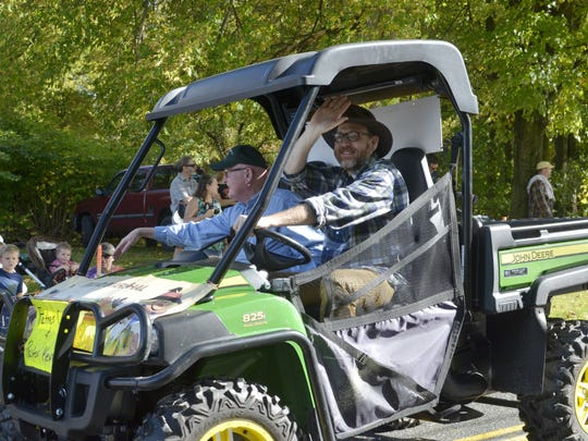 Fr. David Cray, left, and Rev. Kevin Goldenbogen, both religious leaders in Charlotte, serve as grand marshals for the annual East Charlotte Tractor Parade on Sunday, Oct. 8, 2017.