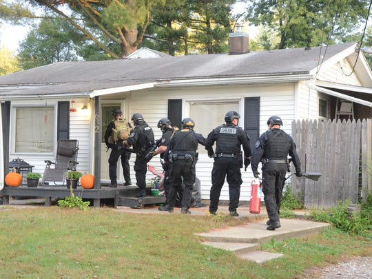 The Special Response Team of the Calhoun County Sheriff Department breaks in a door in Bedford Township Tuesday.