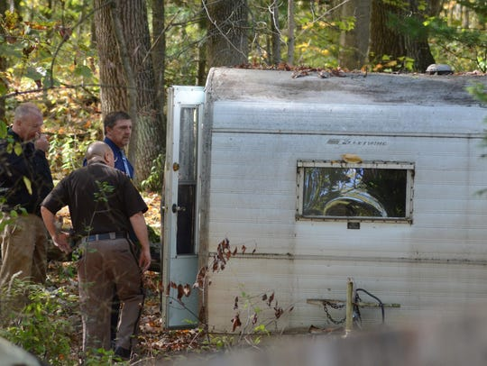 Deputies search a camper Tuesday, Oct. 17, 2017 where