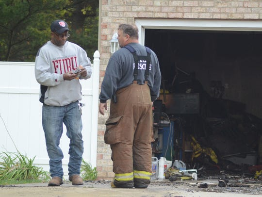 Homeowner Floyd Parker talks with Pennfield Fire Chief