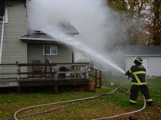 Firefighters said a fire Tuesday, Oct. 24, 2017 in a Newton Township started in the rear of the farmhouse.