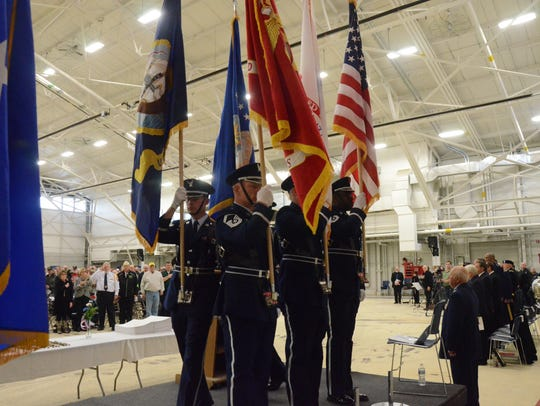 The Honor Guard presents the colors.