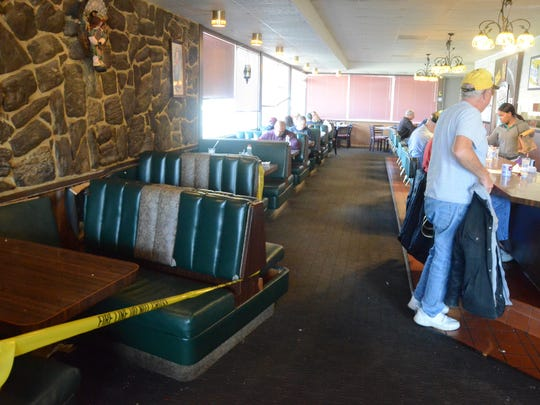 Several booths were dislodged after a car hit the outside of the Home Spun Restaurant on Sunday.