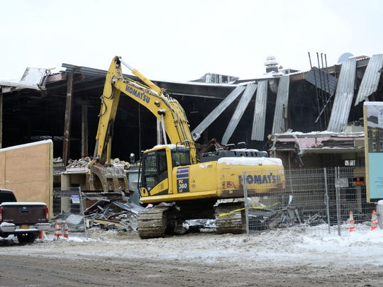 Outside demolition of Burlington City Place, formerly the Burlington Town Center mall, began on Wednesday, Dec. 13, 2017.
