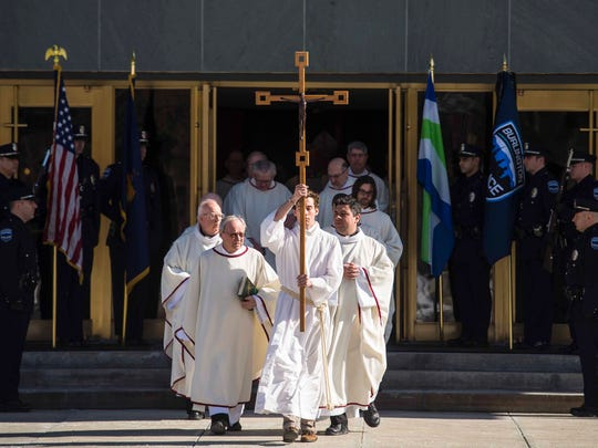 A procession leaves the Chapel of St. Michael Archangel after funeral services for developer and philanthropist Antonio Pomerleau at St. Michael's College in Colchester on Tuesday, February 13, 2018.