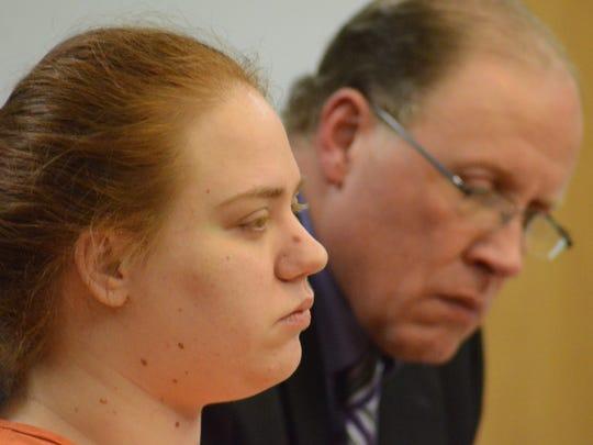 Megan Schug with her attorney, Ronald Pichlik.