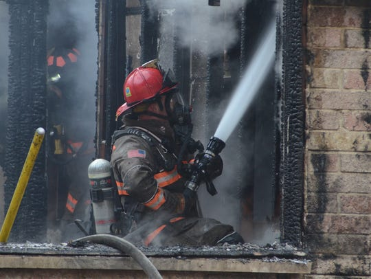 About 50 firefighters from three departments battled
