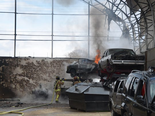 Cars were burning inside a work area at Great Lakes