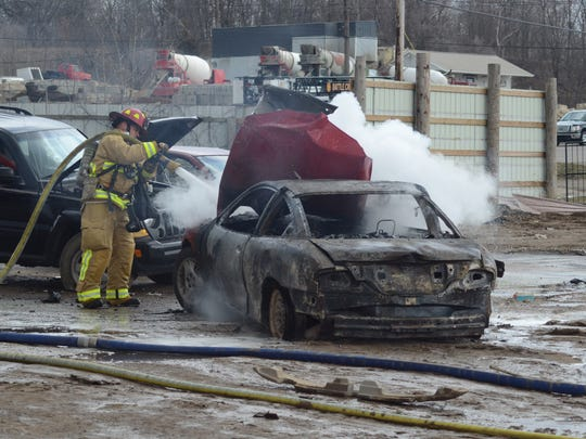 One of the cars was pulled into the yard where firefighters could finish extinguishing the blaze following a fire at Great Lakes Recycling, 1021 N. Raymond Road, Monday, April 9, 2018.
