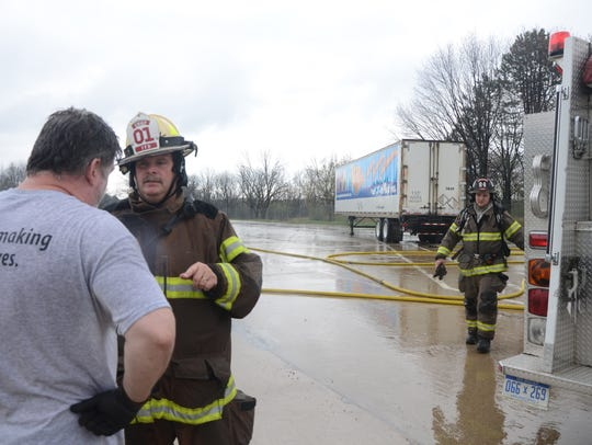 Tekonsha Township Fire Chief Daryl Cummins talks with