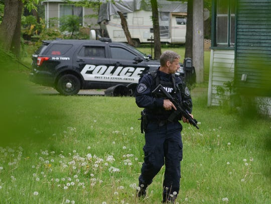 Lt. Matthew Robinson patrols near a house on Somerset