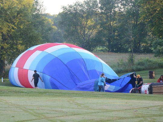 Californian Kelli Keller and her crew begin to inflate the balloon for Tuesday morning's flight.