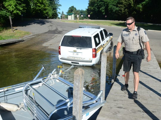 Marine Deputy Dave Winder launches his boat on Duck Lake.