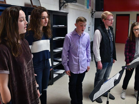 From left, Caroline Presson, Annie Scales and Chase Shaw of Wichita Falls High, Austin Taack and Rebekah Woodward of Rider High perform music from the UIL All-State choir competition.