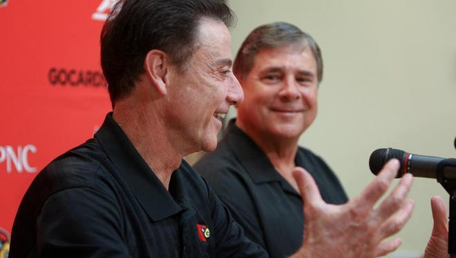 U of L coach Rick Pitino and athletic director Tom Jurich share a laugh during a press conference Tuesday about Pitino's contract extension.