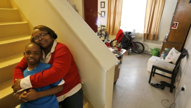 Debra Aldridge, right, poses for a portrait with her grandson, Mario Hendricks, at her home on Chicago's South Side. Nationwide, there are 2.7 million grandparents raising grandchildren. About a fifth have incomes that fall below the poverty line, according the Census figures. More grandparents are taking on the role of parents for their grandkids, as social service agencies try to place foster children in so-called kinship families.