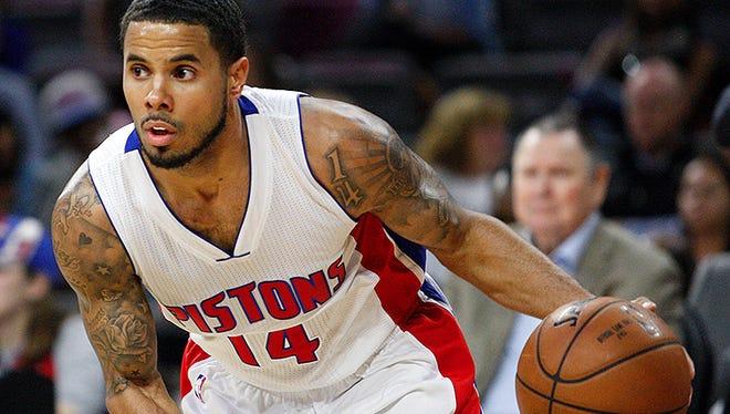 Detroit Pistons guard D.J. Augustin (14) dribbles the ball during the second quarter against the Philadelphia 76ers.