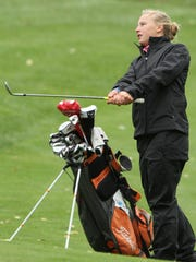Annie Pietila chips onto the green during [ractice