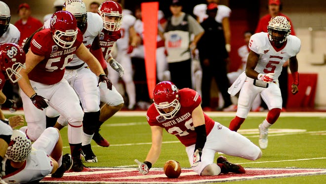 Luke Worden goes for the fumble as the USD takes on ISU at the DakotaDome on the campus of the University of South Dakota on November 15, 2014.