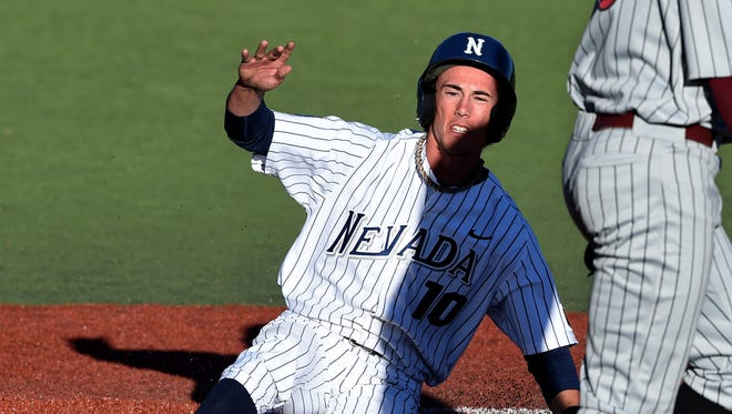 File photo: Nevada's Miles Mastrobuoni slides into home during a game earlier this year at Peccole Park in Reno.