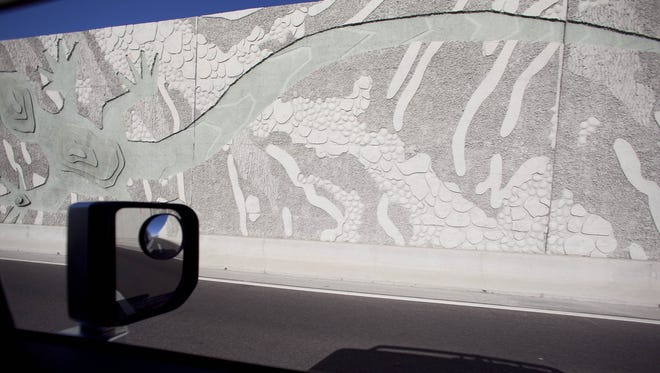 """A section of """"The Path Most Traveled"""" artwork along Loop 101 in Scottsdale."""