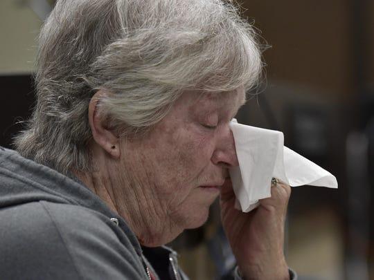 Cynthia Diaz, Gabby Barrett's grandmother, wipes tears