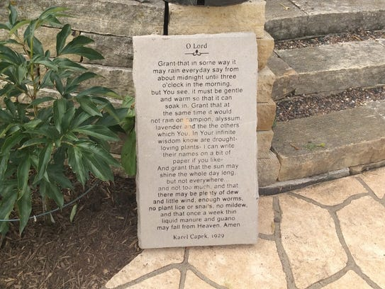 A stone with a gardening poem written in 1929