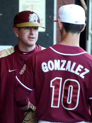 Florida State assistant coach an recruiting coordinator Mike Martin Jr., talks with Justin Gonzalez, who was drafted in the ninth round by the Arizona Diamondbacks.