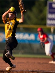 Haylie Foster pitches for Avon High School, which lost