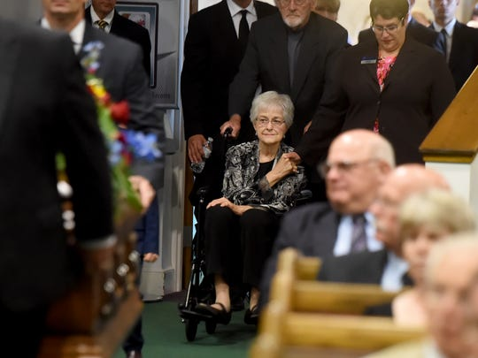 Nona Brown leads a procession into the funeral for her husband, Stan. He died in late 2017, and she died not long after, in January 2018. Together, they ran Brown's Orchard in Loganville.