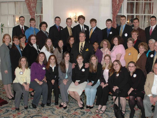Volunteers and alumni of Central PA HOBY met Hugh O'Brian (center, orange pocket square) at Rotary Club of York on Feb. 1, 2006.