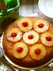 Easy Pineapple Upside Down Cake is topped with caramelized pineapple and cherries.