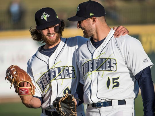 April 6: Tim Tebow talks with teammate Gene Cone before the team's minor league game.